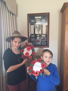 Great grandchildren Henry and Ava Riesewyk paying tribute with their wreathes.
